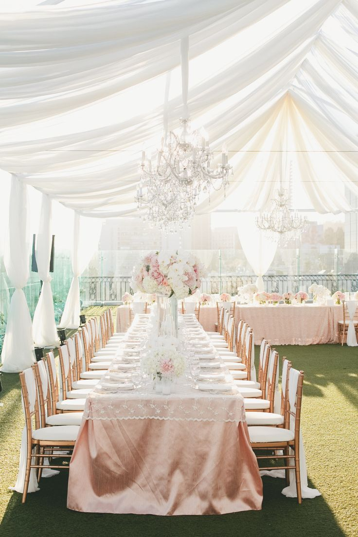 Long Tables in U-Shape under sheer draping -- Lace topper on peach/pink table linens. Love, love, love!! SO much more to see here: http://www.StyleMePretty.com/california-weddings/2014/05/15/pink-and-gold-wedding-at-the-london-west-hollywood/ - Event Design: Kat Keane.com - Floral Design: DolceDesigns.com -  Photography: OneLove-Photo.com - #SMP