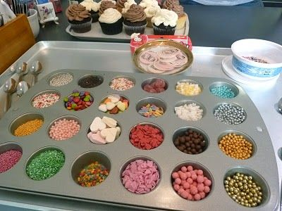 Organizing the toppings for the cupcake bar... did a cupcake activity for kids but this seems soooo fun