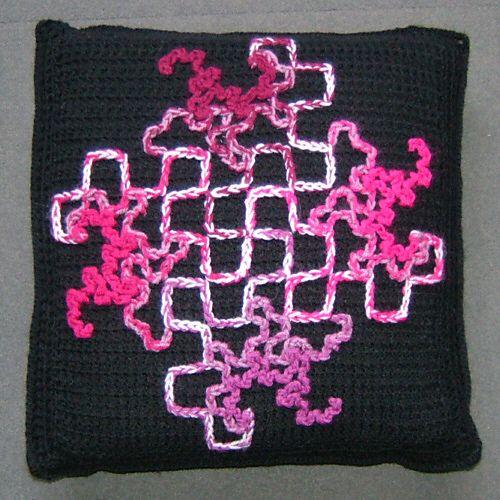 Dragon Curves on a filet crochet cushion