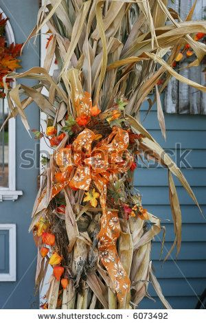 corn stalks decorated with pumpkins and ribbon stock photo from the largest library of royalty free images only at shutterstock - Halloween Corn Stalks