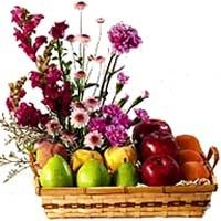 Fresh Fruits Basket with Exotic Colourfull Flowers - Send this basket of high quality fresh fruits (oranges,grapes etc).The exotic colorful flowers are sure to add a dash of brightness to the ambience.