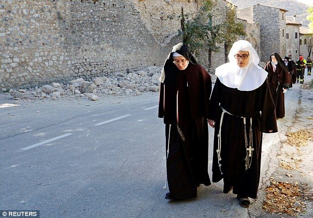 The Benedictine nuns were forced to leave their living quarters after a wall collapsed at the Basilica of St Benedict in Norcia, Italy, 30 October 2016
