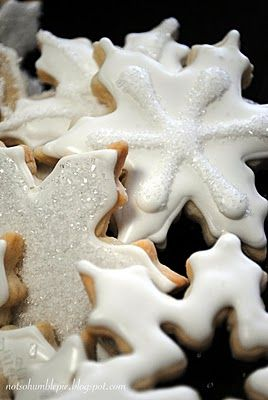 Sparkling Snowflake Sugar Cookies (no recipe, but love the idea of cutting out the center and sprinkling with sugar for sparkle)