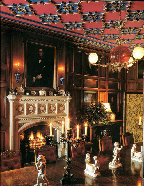 Old World, Gothic, and Victorian Interior Design: Victorian interior gothic interior. Colors are red and blue, typical of that time period, highly decorated ceilings and walls and mantle.