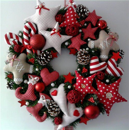 lots of christmas stuffie shapes arranged in  a Christmas wreath.