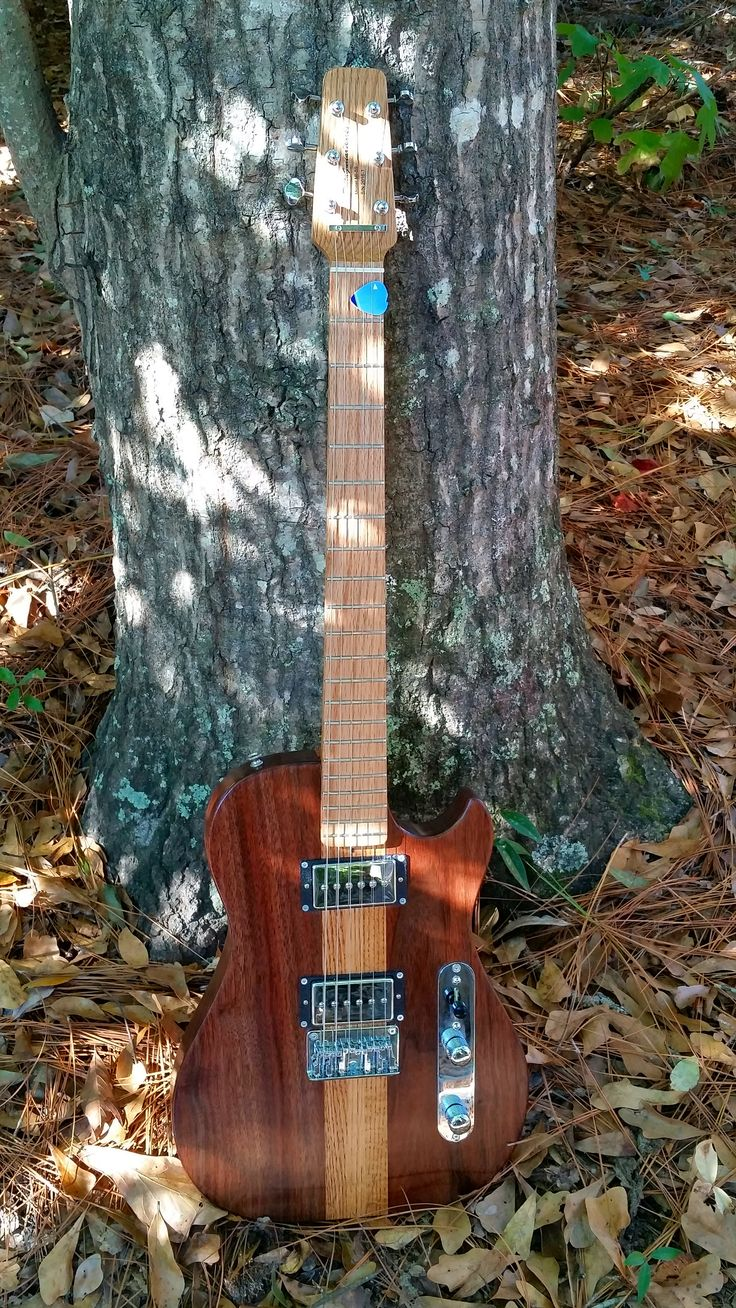 "My design...MI59 single cut.  Body is two piece red oak and black walnut.  Neck is red oak...21 frets and 25"" scale.  GFS humbucker sized P90 pickups."