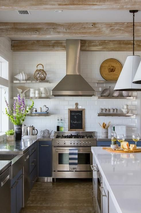 gorgeous cottage kitchen features blue flat front cabinets paired with stainless steel countertops fitted with a stainless steel apron - Stainless Steel Apron Sink