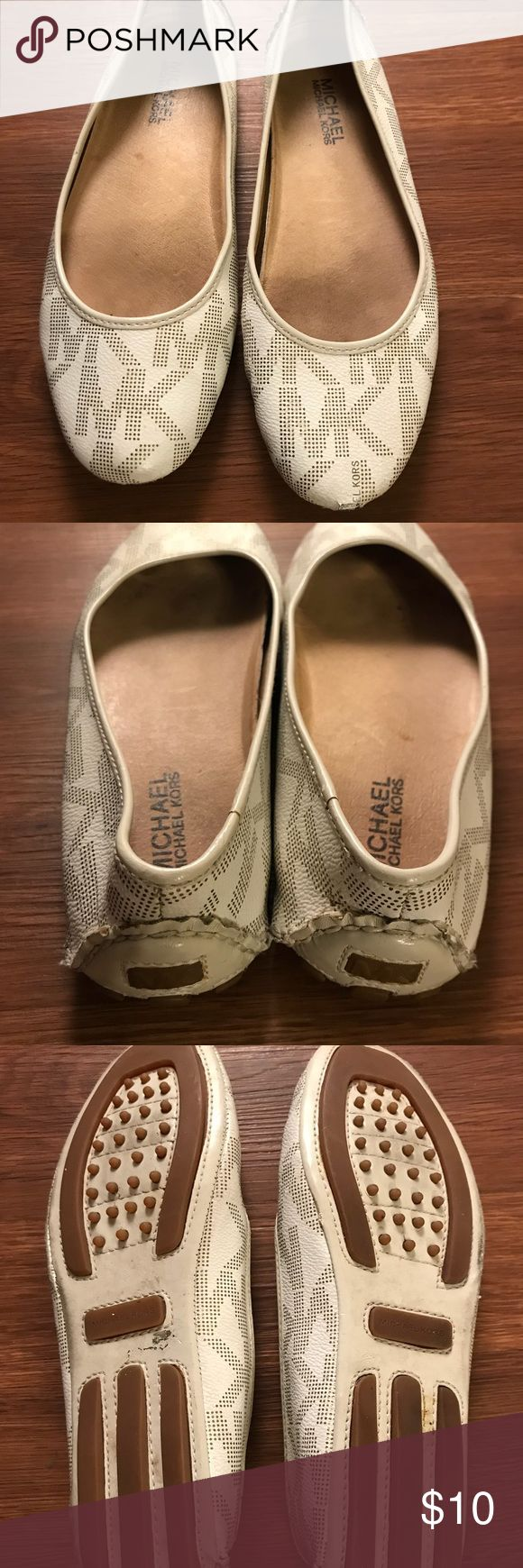 Michael Kors White and Gold Flats Authentic white and gold MK logo flats.  Scrape on left toe.  Otherwise great condition.  Priced to reflect condition.  Could be fixed with white shoe polish I suppose. Michael Kors Shoes Flats & Loafers