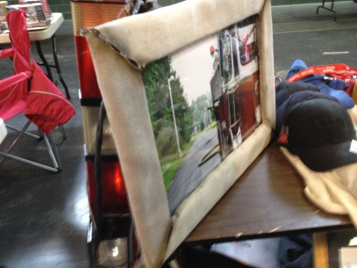 Take and old photo frame plus some hose or turnout gear and make an awesome frame for displaying your photos!