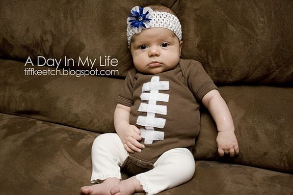 {Football Baby Onsie} This is about the cutest thing ever.