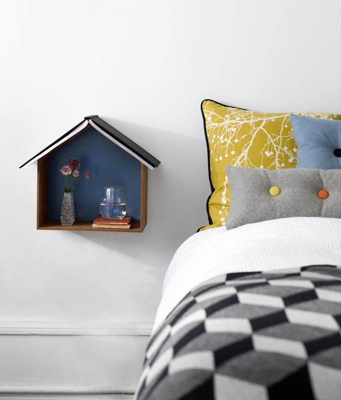 I like the doll house night stand secured to the wall.  Nice way to park book on the roof.  Also like the quilt.