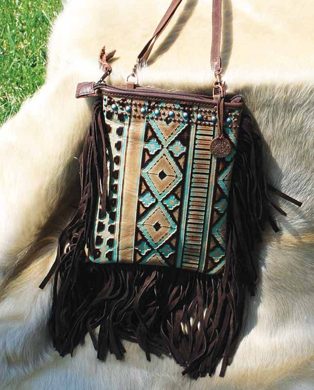 "Double J Saddlery Turquoise and Brown Navajo Cross-body Bag | Aztec Native American geometric pattern chevron western purse women's accessories, fine leather goods, fine leather accessories, handbag, purse, Country Chic casual fashion for women Casual Outfits for women #countryoutfit #countrygirl drysdales.com #CountryFashion ""gifts for cowgirls"" ""gifts for ladies"" ""gifts for women"" ""casual clothing"" for ladies, fringe #fringefashion, studs, studding, arrow, Americana, #bohochic #Winter2015"