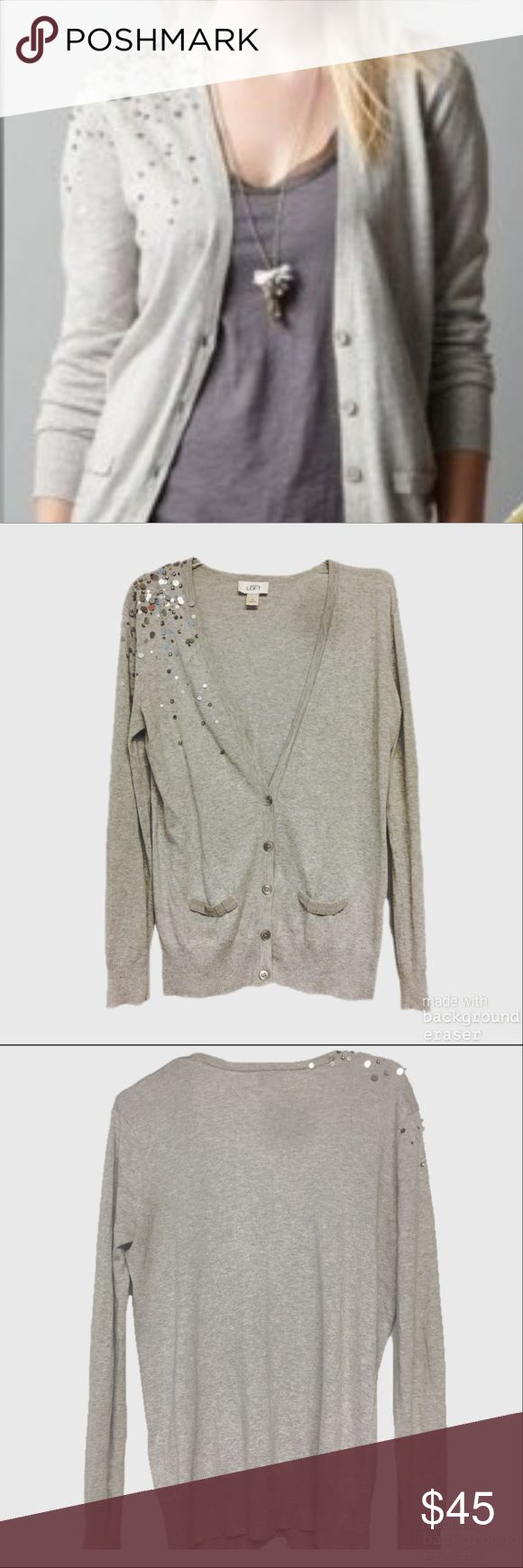 LOFT Sequin Cascade Cardigan This cardigan is sold out!!! Super cute v neck cardigan with cascading sequins and beads along one shoulder down to neckline. All sequins and beads in tact. Only flaw is a tiny pin size hole on sleeve near wrist which is not noticeable when wearing. LOFT Sweaters Cardigans