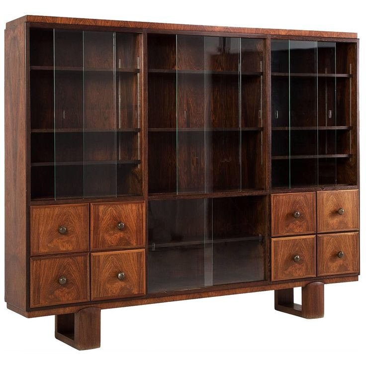 Large Art Deco Two-Section Display Cabinet   From a unique collection of antique and modern cabinets at https://www.1stdibs.com/furniture/storage-case-pieces/cabinets/
