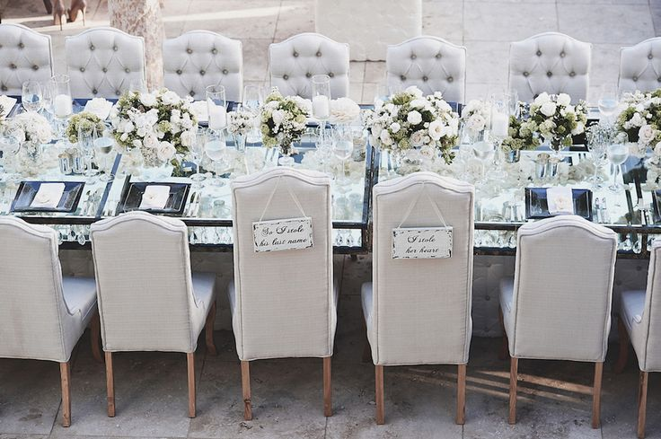 Mirrored Table Surrounded by Tufted Chairs | Photography: Daniel Kincaid Photography. Read More: http://www.insideweddings.com/weddings/brittney-palmer-and-aaron-zalewski/595/