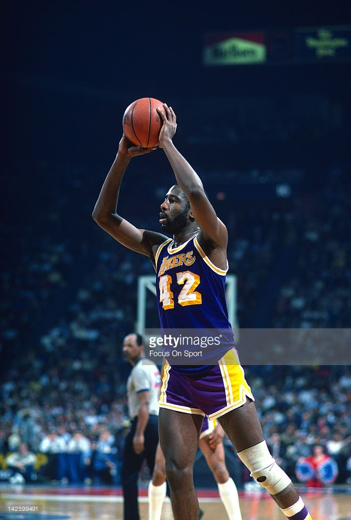 James Worthy #42 of the Los Angeles Lakers looks to make a pass against the Washington Bullets during an NBA basketball game circa 1984 at the Capital Centre in Landover, Maryland. Worthy played for the Lakers from 1982-94.