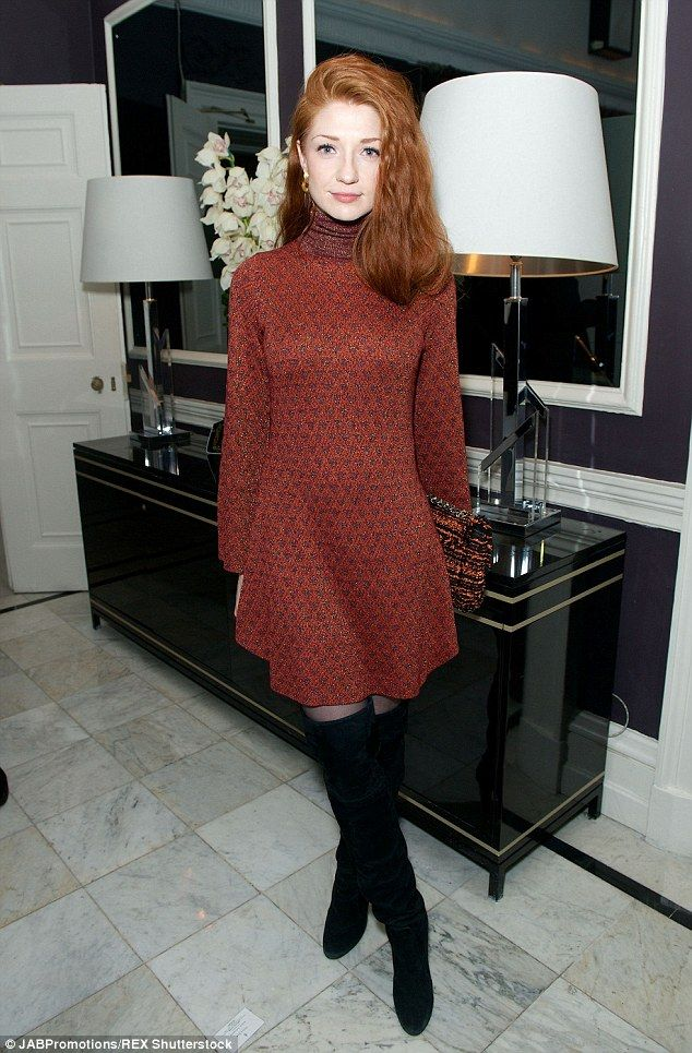 Swinging sixties: Nicola Roberts who went for a 1960s vibe to her ensemble which comprised of a textured burgundy roll-neck dress from Glamorous.com with over-the-knee black boots