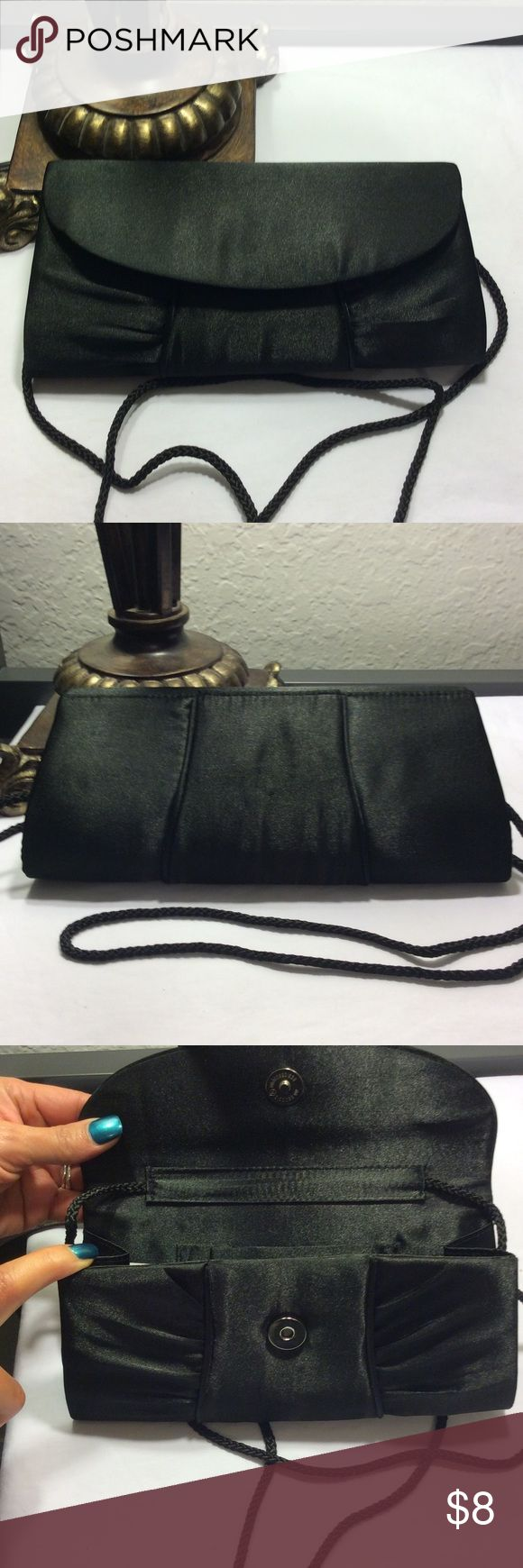 "Black dinner clutch/ handbag. Black, sateen formal clutch with chord styled strap. Dimensions are: 8.5"" L by 4"" H by 0.5"" W. Bags Clutches & Wristlets"