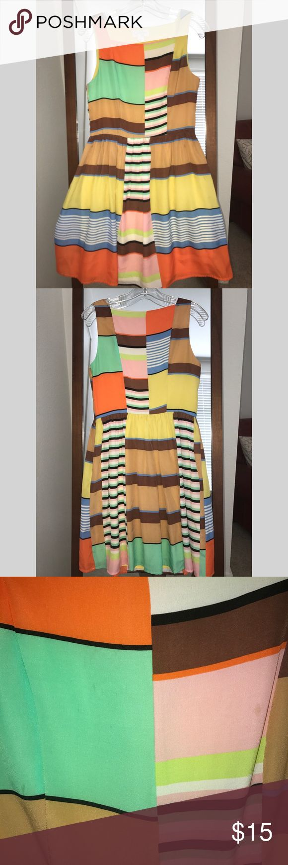 Jessica Simpson Color-blocked festive dress Super colorful stripe and color blocked print dress will add a burst of fun into your wardrobe. Yellow, orange, pink, green, blue, tan. Hits above the knee. Looks great with flats and heels. Minor stains on front (see photo). Jessica Simpson Dresses Mini
