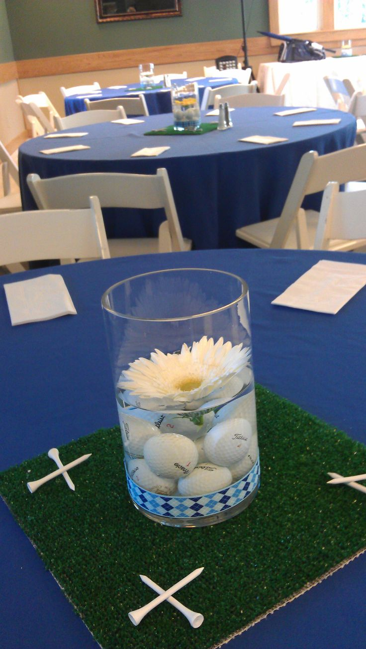 Golf theme table centerpiece for the rehearsal dinner                                                                                                                                                      More