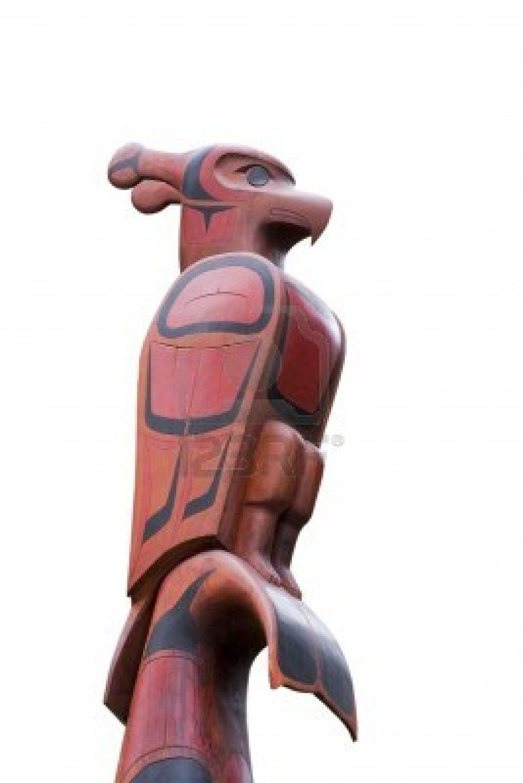 Top of a Totem Pole - Pacific Rim National Park, Vancouver Island, British Columbia, Canada - Totem Pole of the Ucluelet First Nation on the South Beach Trail with a thunderbird, killer whale, bear and a salmon Stock Photo