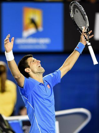1 Feb. 2015 - Serbia's Novak Djokovic celebrates after victory in his men's singles final match against Britain's Andy Murray on day fourteen of the 2015 Australian Open tennis tournament in Melbourne.