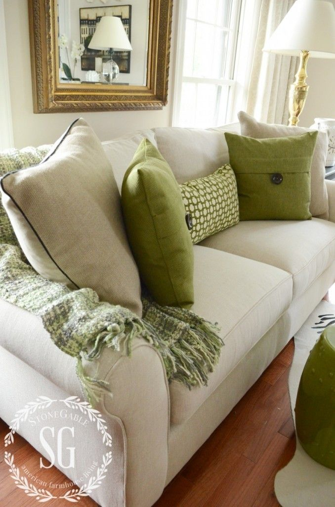 neutral and green pillows on a neutral sofa with a green throw creates a soothing atmosphere - Decorative Pillows For Sofa