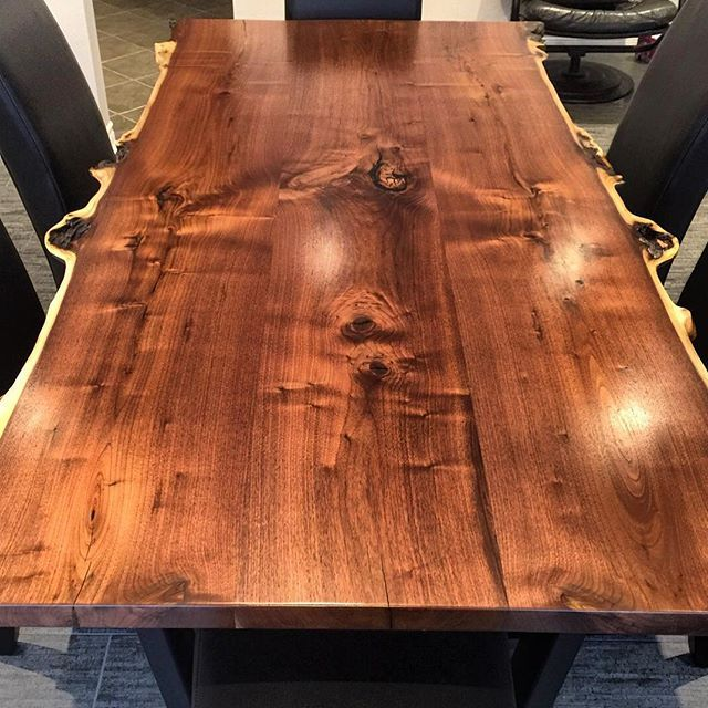 Canadian Black Walnut dining table. Built from 3 boards from the same log for colour/grain matching & a book matched edges.  Tree was salvaged from a Toronto construction site.  Truly One of a kind!
