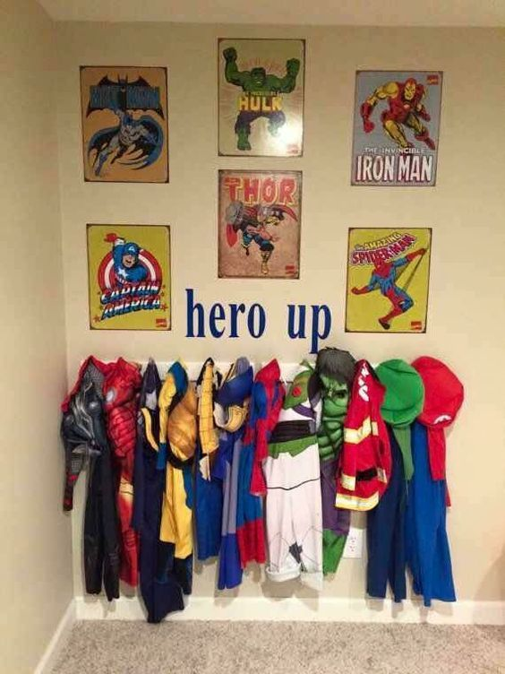 "Hang up a coat rack for all the kids super hero costumes and put a decal saying ""Hero Up"" above it along with posters. Decorate wood letters with super hero paintings! So cool…you can also have customized superhero wall letters made! Hang up a wooden coat rack shelf for the costumes and out action figures …"