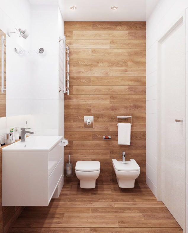 Publicado no site Decor Alternativa, este ambiente está em uma seleção de banheiros decorados com revestimentos que imitam madeira.