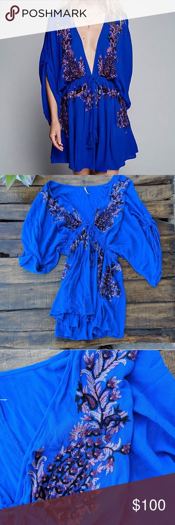 Free People Pretty Pineapple Embroidered Dress Absolutely stunning blue with embroidered purple and pink flowers, cinch & tie waist, deep v neck, flowy dress. Excellent condition!  MEASUREMENTS (INCHES): Keep in mind that the dress is very flowy and there really is no defined shoulder, sleeve or chest area.   CHEST: 17 SHOULDER: 16 LENGTH: 35 1/2 SLEEVE: 23 WAIST: 14 1/4 Free People Dresses Mini