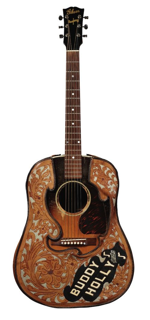 Buddy Holly | Gibson J-45 (circa 1944).    I just watched a youtube clip of Graham Nash (Hollies; Crosby, Stills, Nash and Young) being given this very guitar in a recent interview to play Peggy Sue for the audience.  He was very honored.  He also said he owned a Johnny Cash guitar.