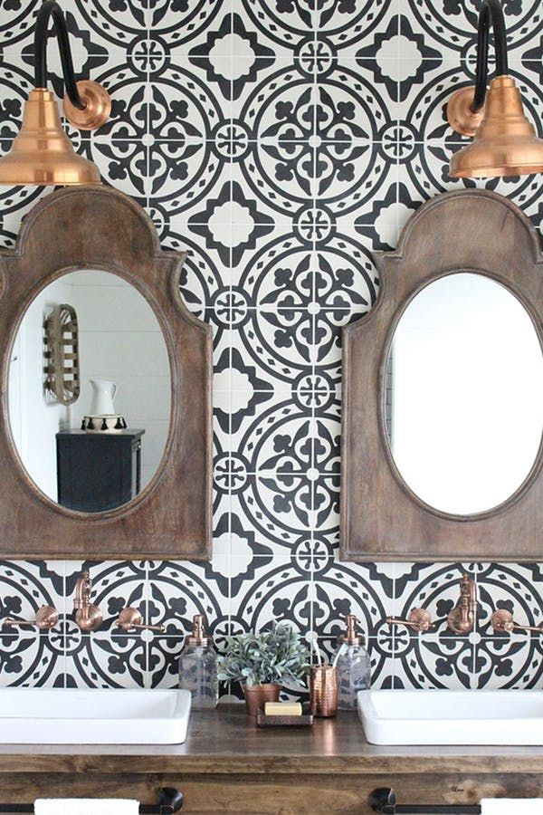Try A Cement Statement Wall - Both practical and beautiful, a rustic double vanity sink sings against black-and-white Moroccan tile backsplash.