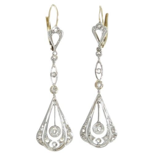 A pair of Edwardian earrings made in platinum topped 18ct yellow gold each made as an open drop frame with a triple scallop to the base each pierced and diamond set. www.rutherford.com.au