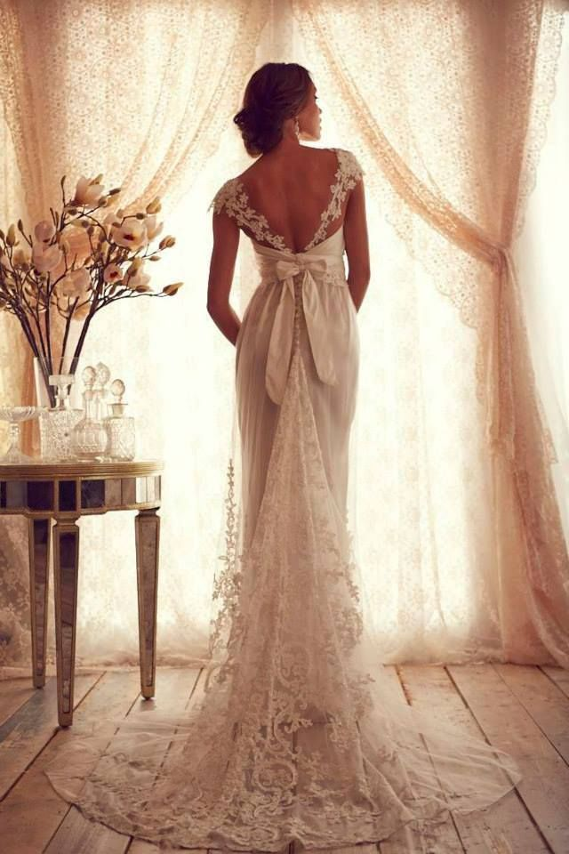 Stunning lace wedding dress with bow