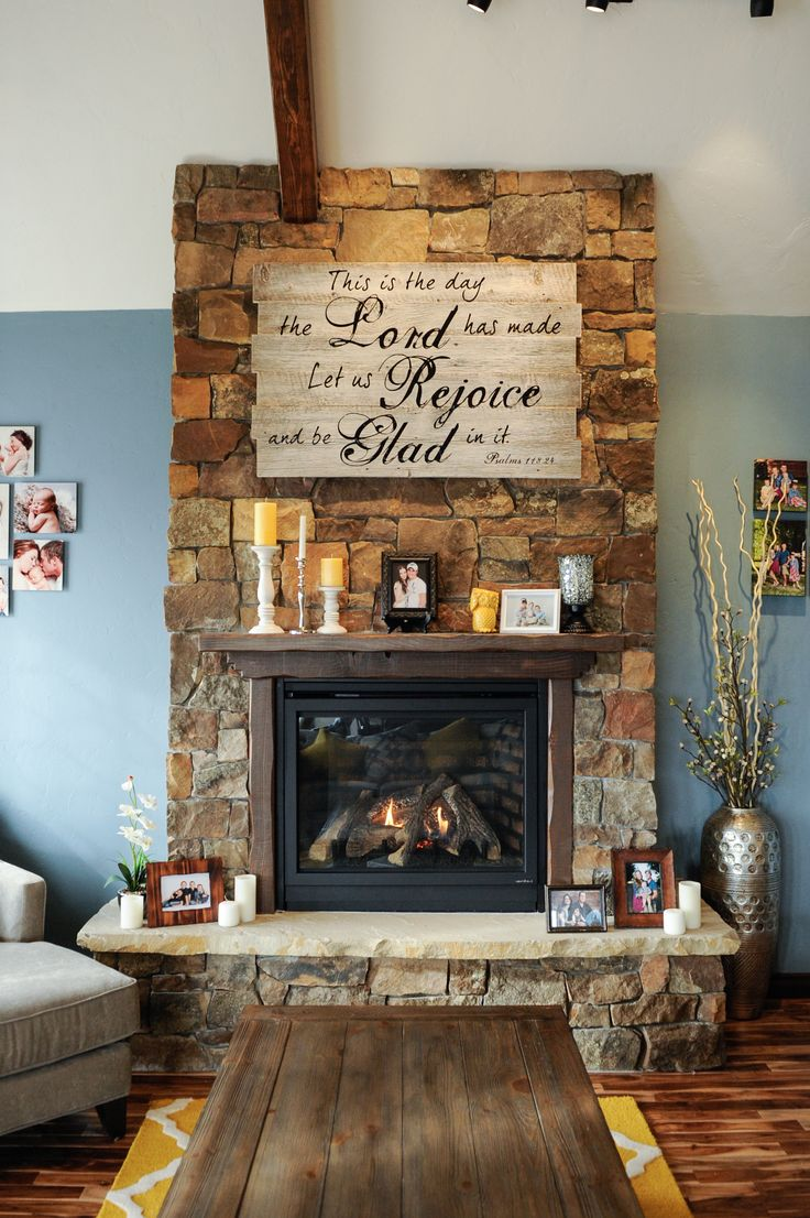 my rock fire place in living room.. dIY fire place sign!