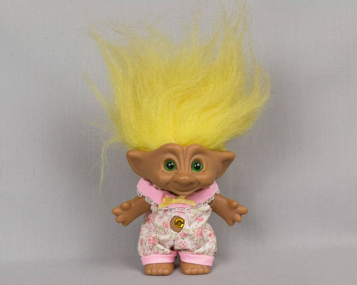 Ace Novelty Co. Troll Doll Yellow jewel and hair Blue eyes with black pupils Removable rompers Smiling face Wide pointed ears Signed by eyespytreasure on Etsy