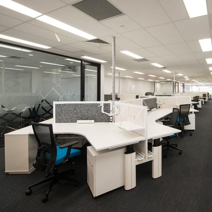 The Warranty Group | Camberwell, VIC. Designer: Cube Company. UCI Supplied: Paradigm 120 degree height-adjust workstations and executive desks. Photo by John Best Photography. uci.com.au