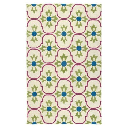 Add a pop of pattern to your master suite or den decor with this hand-tufted New Zealand wool rug, showcasing a quatrefoil-inspired trellis motif for a touch...