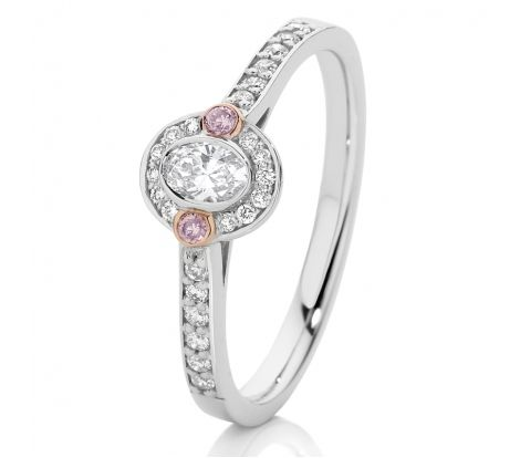 This beautiful 18ct white gold engagement ring features an oval shaped diamond centre stone with grain set shoulders including 2=0.03ct of natural pink diamonds set in rose gold accents to make the pinks really pop! With a TDW of 0.35ct this stunning ring will bring a lifetime of joy and appreciation.