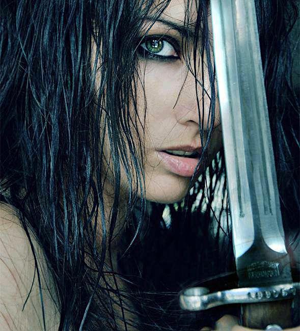 The green Erin eye of the female warrior.