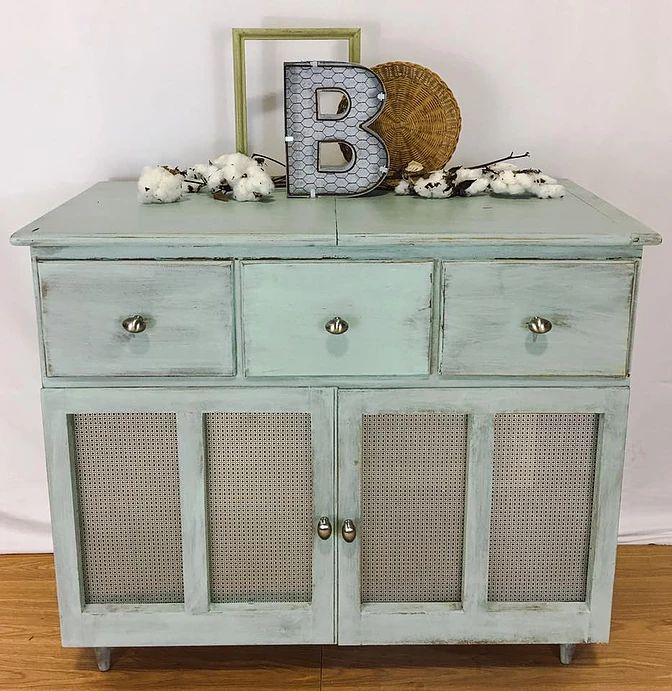 Repurposed Record Cabinet finished with The Real Milk Paint Beachglass. Refitted with decorative tin door fronts