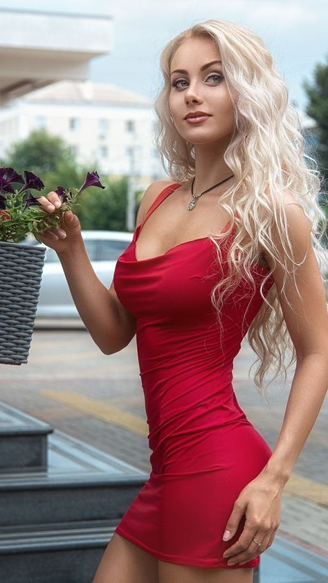 Can suggest Sexy blonde red dress likely. Most
