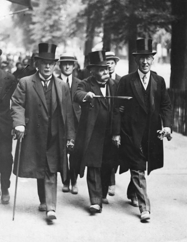 What You Need to Know About the Treaty That Ended WWI: British Prime Minister David Lloyd George (left), French Prime Minister Georges Clemenceau (center), and American President Woodrow Wilson (right) on their way to the Versailles Peace Conference.