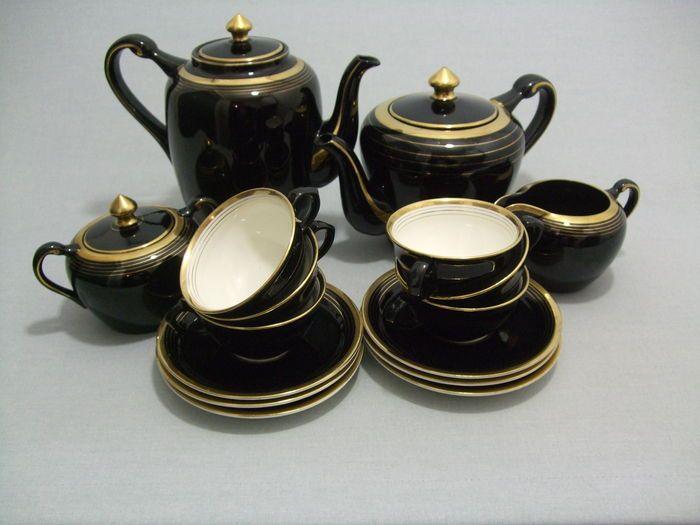 Societe Ceramique - koffie-theeservies - hoogglans zwart met goudkleurige accenten