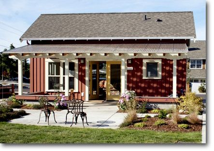 Red Sided Small Home With White Trellis For Covered Back