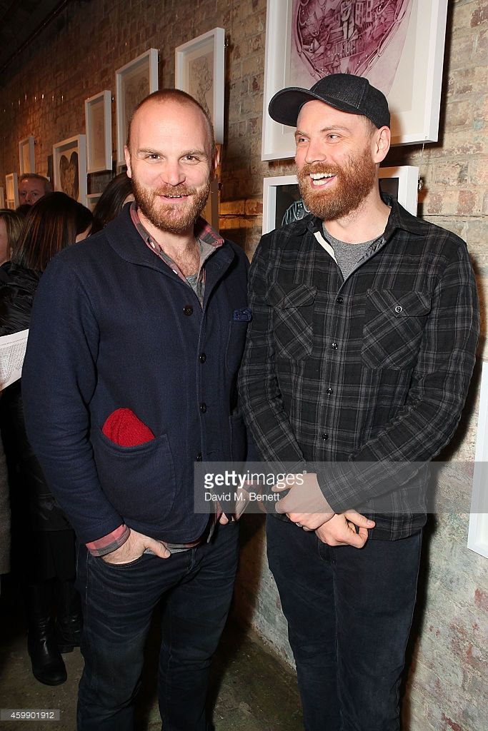 Will Champion and Jonny Buckland attend a private view of 'Coldplay: Ghost Stories', an exhibition of artwork by Mila Furstova from the band's latest studio album in aid of Kids Company, at StolenSpace Gallery on December 3, 2014 in London, England.