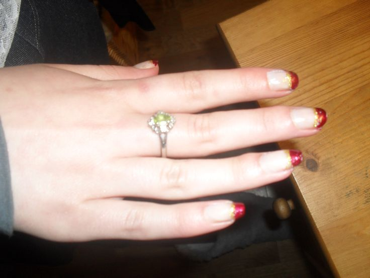 Instead of the classic french manicure, I did a red french tip manicure with a stripe of gold underneath. This was a really long time ago.