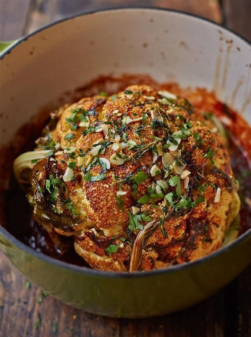 Whole roasted cauliflower with a thyme & paprika rub. Charred and crunchy on the outside, tender on the inside with a tasty tomato sauce.   Jamie Oliver