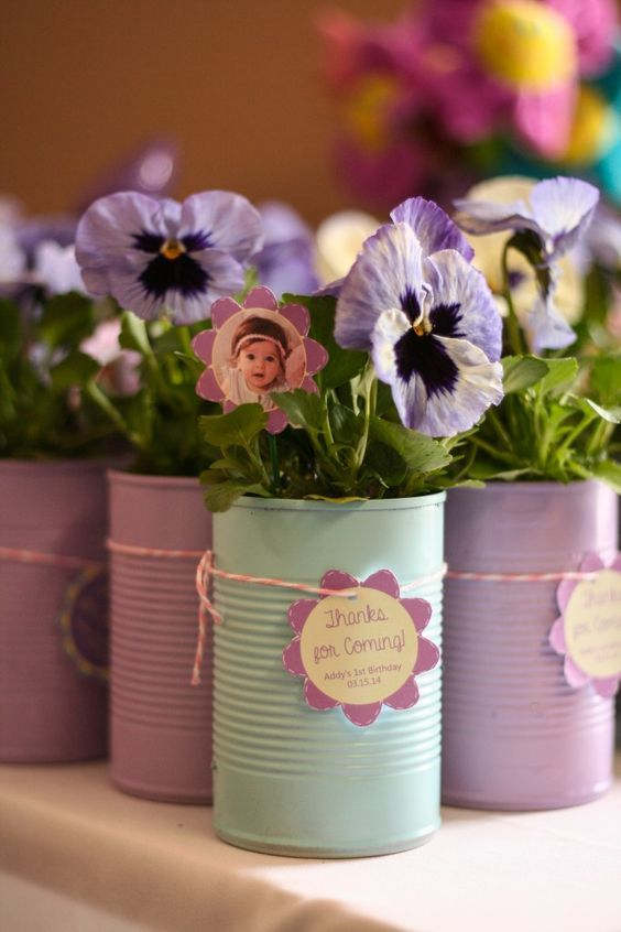 Spring-themed First Birthday Party Favors. Give guests a cute potted pansy as a favor!
